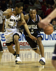 BUTLERS JACKSON DRIVES THE LANE.