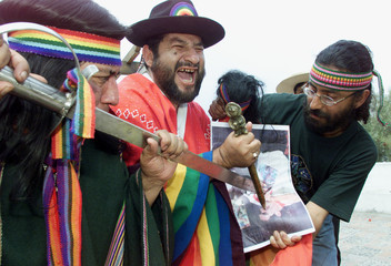 PERUVIAN WITCH DOCTORS PLUNGE KNIVES INTO SALAS PICTURE IN AREQUIPA.