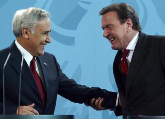 ISRAELS PRESIDENT KATSAV AND GERMAN CHANCELLOR SCHROEDER LAUGH INBERLIN.
