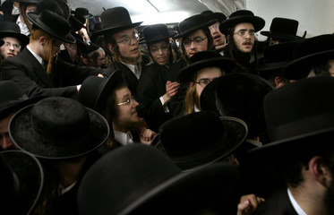 Ultra-orthodox Jews push to see their rabbi during a special speech for the Jewish 'Tu B'Shvat' ...