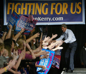 U.S. Democratic presidential nominee Kerry reaches out to supporters at rally in Tampa.