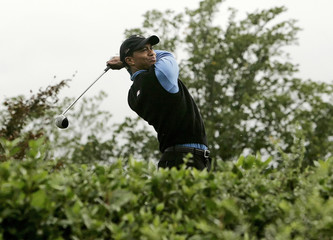 U.S. Ryder Cup player Woods tees off on the seventh tee during their fourball golf match at the Ryder Cup in County Kildare