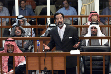 Former Iraqi president Hussein addresses the court during a trial in Baghdad