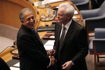 U.S. Ambassador to the United Nations Zalmay Khalilzad greets Russian Ambassador to the United Nations Vitaly Churkin in New York