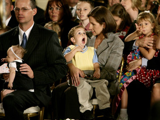 Child pulls a face during remarks by US President Bush against federally-funded stem cell research in Washington