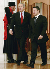 U.S. President George W. Bush walks with Jordan's King Abdullah at Raghadan Palace in Amman, Jordan