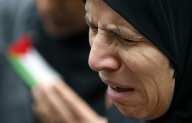 A woman cries during an anti-Israel protest organised by the General Union of Palestine Students Organisation in New Delhi