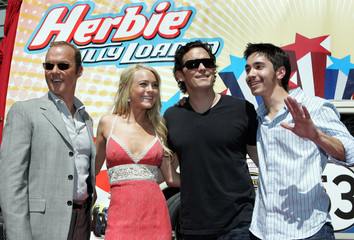 "Actress Lindsay Lohan and members of the cast pose at the World Premiere of ""Herbie Fully Loaded"" in ..."