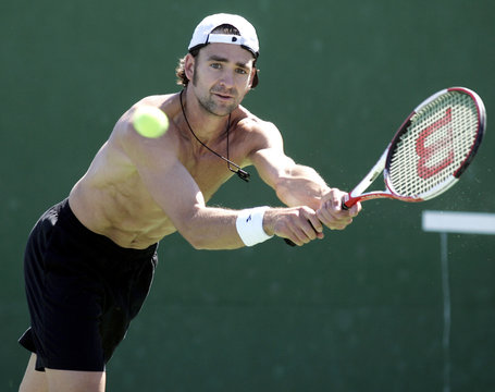 Nicolas Kiefer lunges for backhand during his tennis workout at Pacific Life Open in Indian Wells