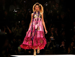 A model wears a creation by [India]'s Manish Arora at his Autumn/Winter 2006 show during London Fash..