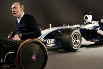 Williams, Managing Director of the Williams team, passes Williams team Formula One car at headquarters in Oxfordshire, southern England