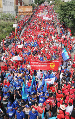 Thousands of supporters of Venezuelan President Chavez take part in rally in Caracas