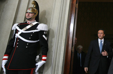 Alleanza Nazionale leader Gianfranco Fini arrives for speaking to reporters after consulting with Italian President Giorgio Napolitano at the quirinale palace in Rome