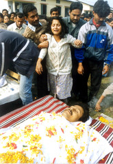 MITALI WEEPS AS THE BODY OF HER FIANCE AVINASH BORDOLOI LAYS IN FRONT OF HER.