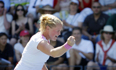 Groenefeld of Germany reacts to winning a point against Hantuchova of Slovakia at the U.S. Open tennis tournament in Flushing Meadows