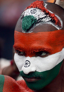 Cricket fan with his hair styled as Indian map waits for play to resume in Mohali, India