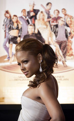 """Milian poses for pictures at the world premiere of """"Be Cool"""" in Hollywood."""