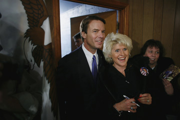 U.S. Democratic presidential candidate and former Senator John Edwards poses for a photo with Jean Salz as he campaigns in Algona