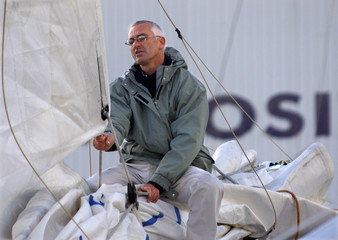 French skipper Yves Parlier checks the main sail of his boat at Les Sables D'Olonne harbour on Franc..