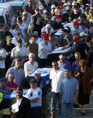 FIVE COFFINS OF ALMOG FAMILY ARE CARRIED DURING FUNERAL CEREMONY INHAIFA.