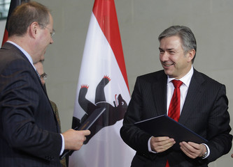Berlin's mayor Wowereit and German Finance Minister Steinbrueck exchange new signed contracts at Chancellery in Berlin