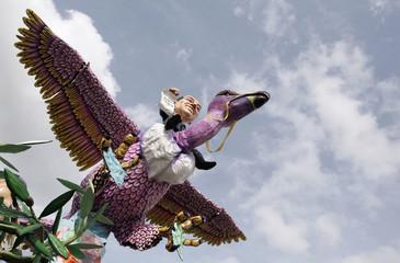 Carnival float depicting Italian PM Berlusconi riding giant bird takes part in carnival parade in Viareggio