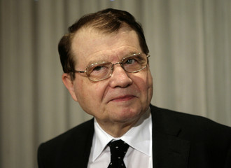Dr. Luc Montagnier, co-discover of the Human immunodeficiency virus (HIV), arrives for a news conference at the National Press Club in Washington