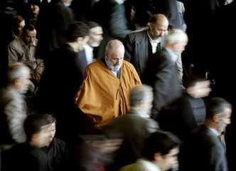 An Iranian worshipper prays at a University others leave after Friday prayer ceremonies in Tehran, I..