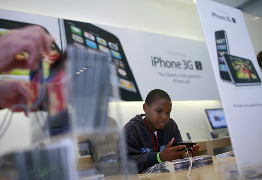 Vincent Talley looks at an Apple iPhone 3GS at the Apple retail store in San Francisco