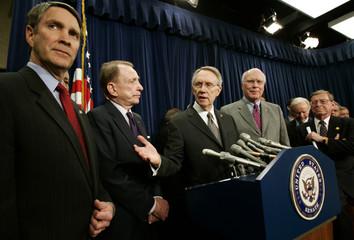 US Senate leader Reid speaks alongside Frist and Senator Specter in Washington