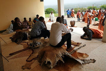 Africa's youngest tribal ruler Nyimba is greeted by a faithful at his palace in Fort Portal in west of Uganda