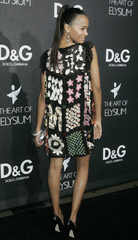 Actress Zoe Saldana poses at the opening of the Dolce & Gabbana flagship boutique in Los Angeles