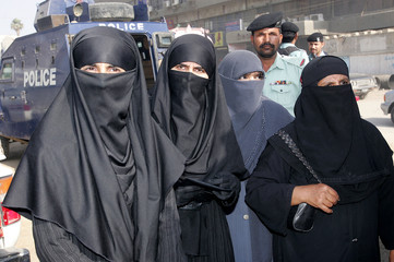 Relatives of the al Qaeda-linked members of an Islamic group arrive outside a court in Karachi