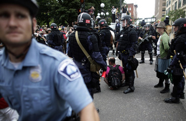 Riot police detain protesters after demonstrations turned violent during the second session of the 2008 Republican National Convention in St. Paul, Minnesota