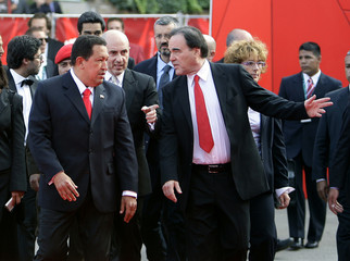 U.S. film director Stone and Venezuela's President Chavez arrive for a red carpet at the 66th Venice Film Festival