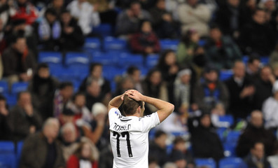 Real Madrid's Arjen Robben reacts after losing a chance to score during their Champions League soccer match against Zenit in Madrid