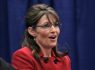 Sarah Palin talks to her fans at a book signing event for her new book 'Going Rogue' at a Barnes and Noble book store in Grand Rapids Michigan