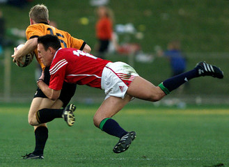 BRITISH LIONS PLAYER TAYLOR TACKLES NEW SOUTH WALES COUNTRY PLAYER CROFT DURING MATCH IN COFFS HARBOUR.