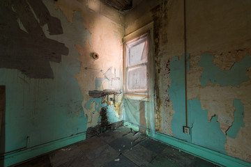 empty hotel room in dilapidated hotel