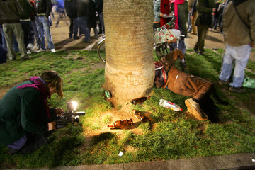 """A student sleeps during """"macrobotellon"""" a drinking session in Barcelona"""