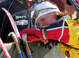 Bailly of France relaxes after victory in women's 12.5 km mass start at Biathlon World Cup Final ...