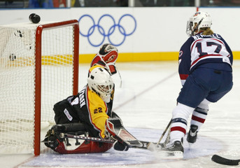 USA SCORES SEVENTH GOAL AGAINST GERMANY IN WOMENS ICE HOCKEY.