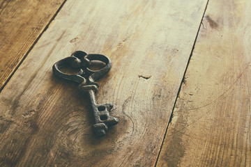 Image of antique keys on old wooden table