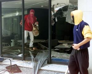 ANTI-GLOBALISATION PROTESTORS BREAK INTO BANK IN BARCELONA.