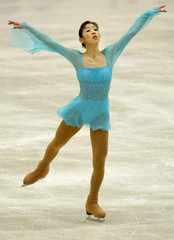 JAPAN'S SUGURI PERFORMS ON WAY TO WIN GOLD AT FIGURE SKATINGCOMPETITION IN ASAHIKAWA, JAPAN.