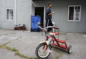 Vicente Oliveros stands outside the apartment he is being evicted from in Los Angeles