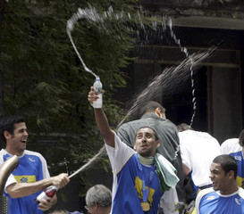 Brazil's Marcelinho and Sergio Escadinha celebrate during their arrival in Sao Paulo