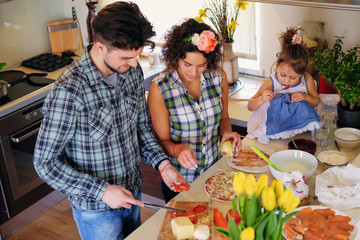 Happy family  cooking food in a home kitchen.