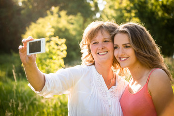 Senior mother with daughter selfie