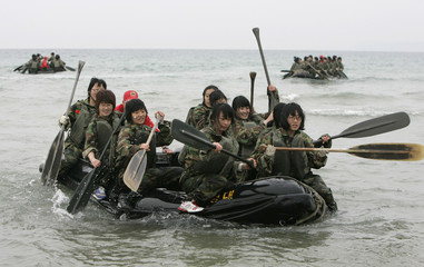 Students participate in a winter military camp organised by marine corps in Pohang